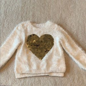 Fuzzy white sweater with gold sequin heart